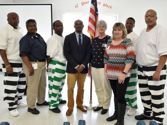 The Soldier On Incarcerated Veterans program at Central Mississippi Correctional Facility in Pearl celebrated Veterans Day. Left to right are, Drexel Brown, U.S. Army; Sgt. Tracey Howell, MDOC Correctional Officer; Daniel Robinson, U.S. Navy; Alvin Buckley, U.S. Marine and Soldier On Employment Specialist; B.R. Hawkins, Soldier On Director, Veterans employment; Deputy Warden Vivian Frazer, MDOC Program Supervisor; Bruce Boyd, U.S. Marines; and Leon Edwards, U.S. Navy Reserves.