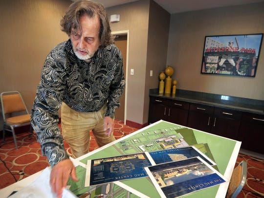 Developer Kenny Farrell pulls out ambitious plans for a new mixed-use development  being built off Interstate 55 in Marion, Arkansas. Called Angelo's Grove, the development was stalled during the recession but is now starting to take off.