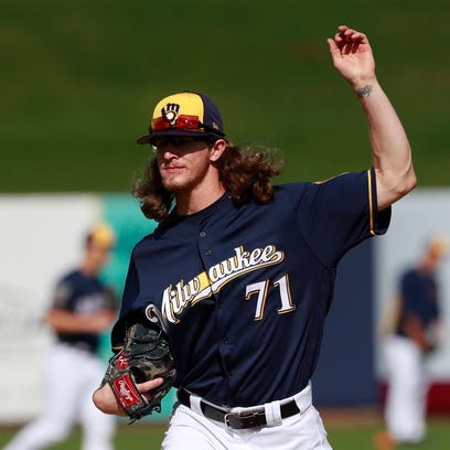 Brewers relief pitcher Josh Hader goes through a pitching