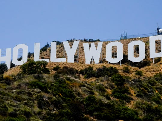The Hollywood sign on Mount Lee is one of the most-photographed tourist attractions in Los Angeles.