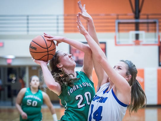 Yorktown's Brooke Kobza struggles against Tipton's
