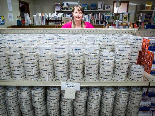 Stacy Wheeler stands near  newly acquired school supplies