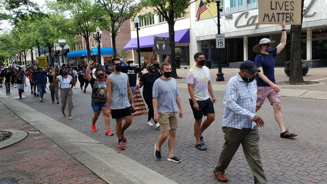 Marchers protesting racial discrimination head to the Market House in downtown Fayetteville on the afternoon of Saturday, July 11, 2020.