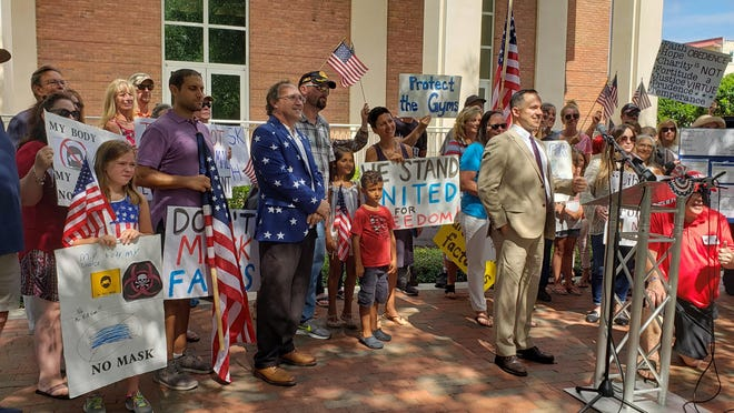 Several DeLand residents gather outside City Hall, 120 S. Florida Ave., on Monday, July 13, 2020, as a show of support for a lawsuit against the city over its mask mandate amid the coronavirus pandemic.