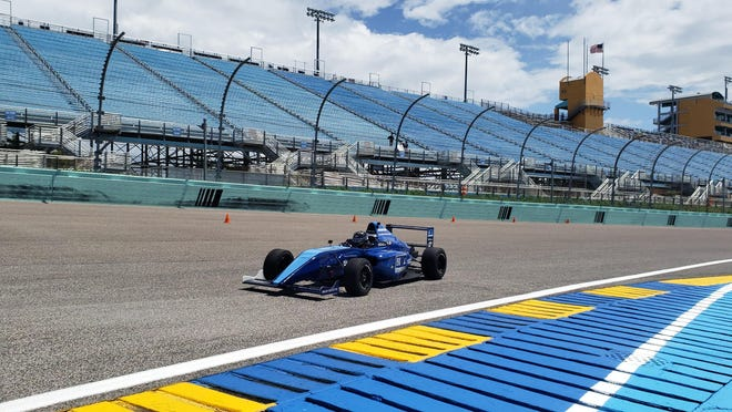 Thirteen-year-old Emerson Fittipaldi Jr. takes a few laps around Homestead-Miami Speedway during a test drive last month in a FIA Formula 4 car.
