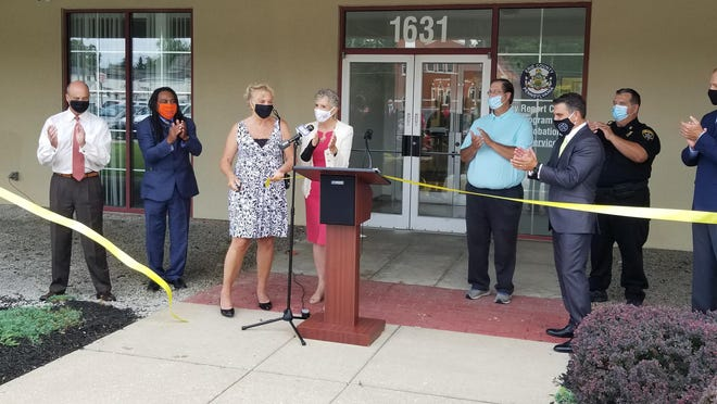 Former Erie County Councilwoman Carol Loll, third from left, and other officials opened the Erie County Community Resource Center, 1631 Sassafras St., on Thursday. The facility includes a day reporting center, which Loll spent two decades advocating for.