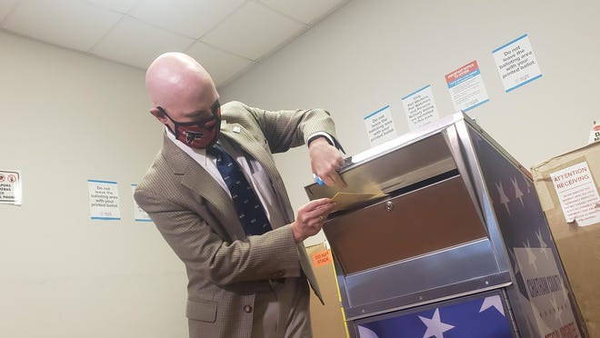 Chatham County Board of Registars Chairman Colin McRae on Wednesday demonstrates the use of Chatham County's new absentee ballot drop boxes, purchased by the League of Women Voters of Coastal Georgia.