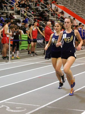 Caroline O'Sullivan (right) and Mary Scrivanich) go 1-2 for Northern Valley/Old Tappan in the Big North National 1,600. The duo combined for 3 wins and 46 points for the champion Golden Knights.