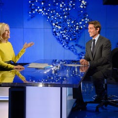 "Diane Sawyer (left) signs off on her last broadcast as anchor of ""World News,"" with new anchor, David Muir (right) looking on in New York."