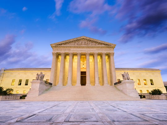 The front of the U.S. Supreme Court in the evening