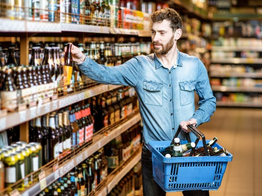 A man shops for beer.