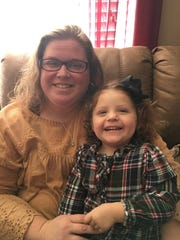Tana and Teegan Benson pose together in a photo. Teegan, 2, is the subject of a hilarious viral video in which she, while playing a sheep in a Nativity scene, took baby Jesus out of his manger and started dancing with him.