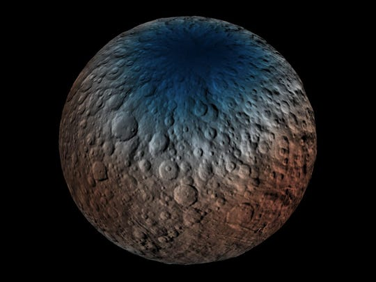 A color-enhanced view of the cratered surface of Ceres.
