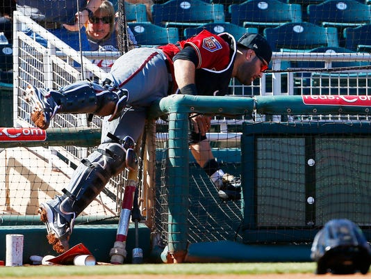 Arizona Diamondbacks catcher Alex Avila makes a diving catch on a foul ball hit by Cincinnati Reds' Dilson Herrera during the second inning of a spring training baseball game Monday, Feb. 26, 2018, in Goodyear, Ariz. (AP Photo/Ross D. Franklin)