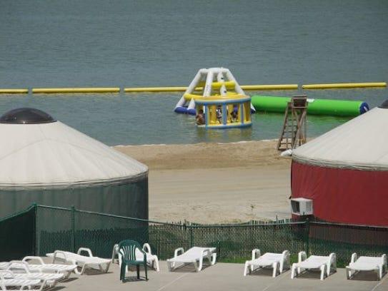 Yurts sit along the beach at Crystal Lake Campground