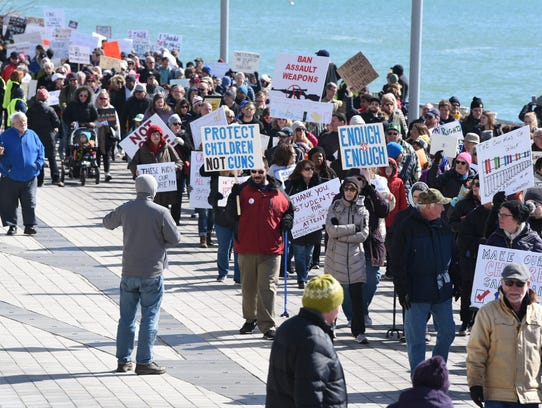 """Thousands hold signs and chant during """"March For Our"""