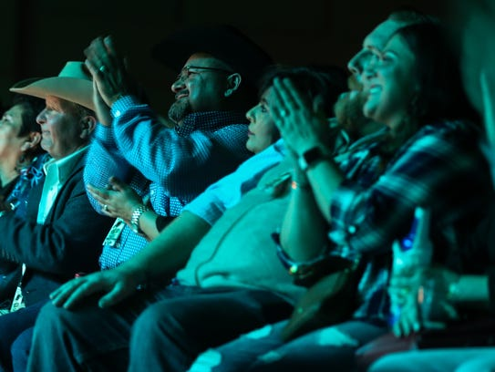 The audience listens to an acoustic performance by