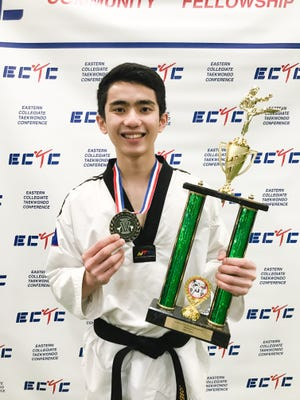 "Joseph ""Jed"" Caluag won the gold medal and the overall trophy at the Eastern Collegiate Taekwondo Conference at University of Vermont April 21."