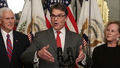 Rick Perry speaks during his swearing-in ceremony,