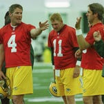 Brett Favre sits dejected on the bench with reserve quarterback Matt Hasselbeck late in the fourth quarter of a 29-10 loss to the Tampa Bay Buccaneers on Dec. 26, 1999, at Raymond James Stadium in Tampa, Fla.