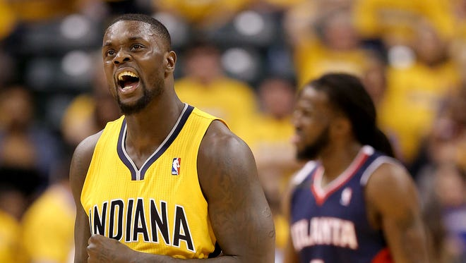 Pacers guard Lance Stephenson reacts on the court against the Atlanta Hawks in the first round of the NBA Eastern Conference playoffs Saturday, April 19, 2014, at Banker Life Fieldhouse.