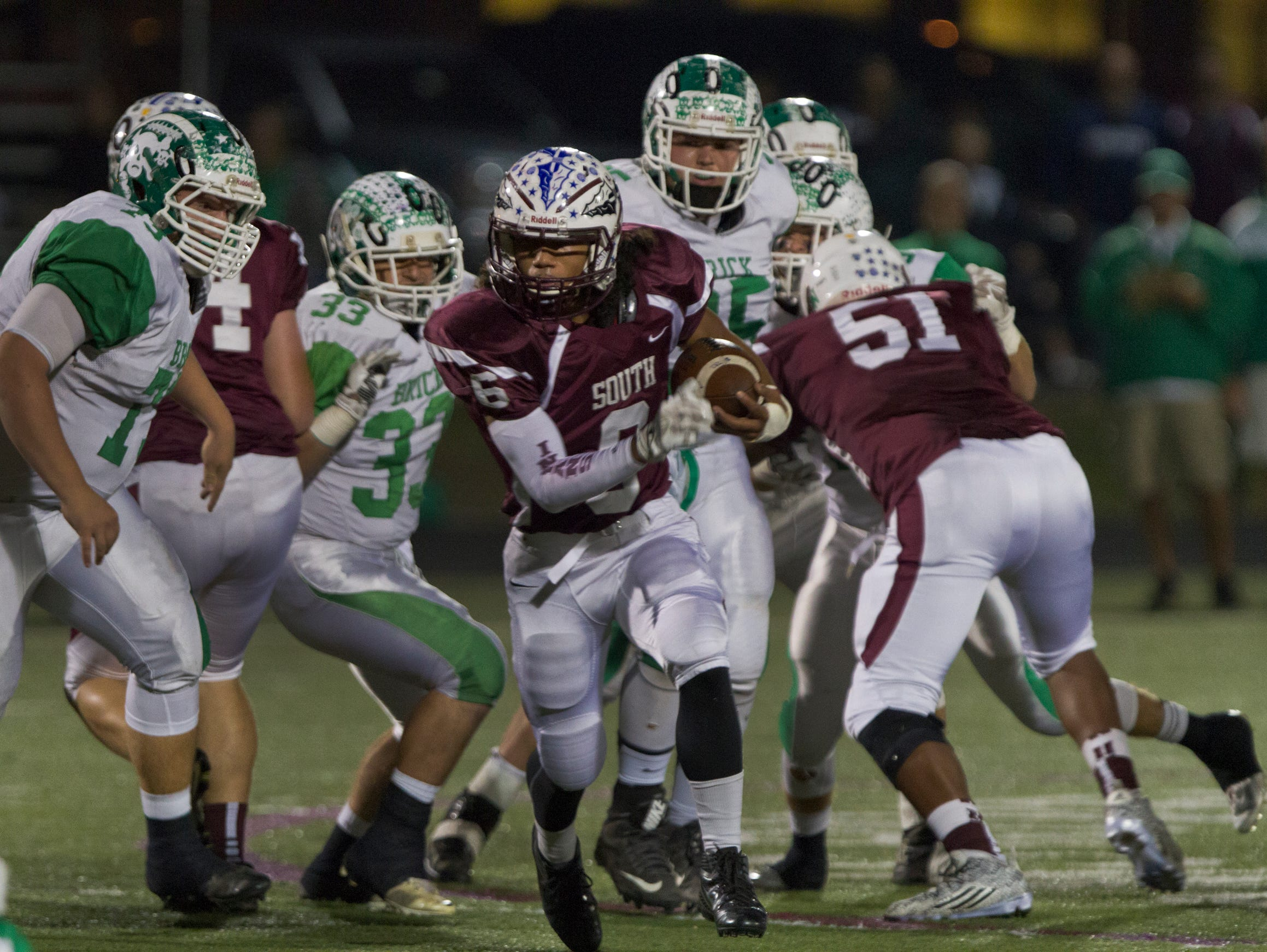 Toms River South's Dashaun Alexnder finds running room through the left side during early action in Brick football vs Toms River South on November 6, 2015 in Toms River NJ.