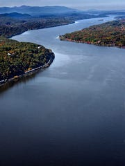 This aerial photograph shows the Hudson River, with a view toward the Catskill Mountain range. Foursquare founder Dennis Crowley is considering the Hudson Valley as a possible site for  a Foursquare office.
