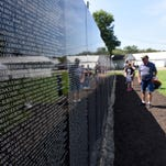 Vietnam veteran Thomas Franklin Schmidt and Barbie Ratcliffe, both of Columbus, read through the list of more than 58,000 U.S. Military personnel who died during the Vietnam War at The Vietnam Memorial Moving Wall in New Lexington. The wall is a mobile replica of the memorial in Washington D.C. and travels throughout the United States.