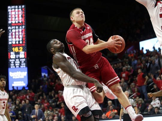 Wisconsin's Brad Davison drives to the basket against Rutgers' Eugene Omoruyi during their game Friday night.