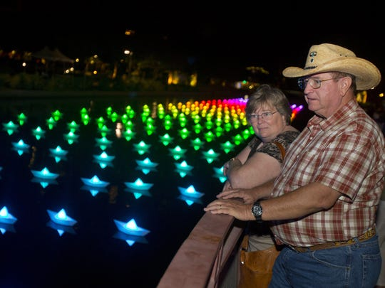 Betty Stewart and her husband, Lee, look out over the art installation Voyage at the Canal Convergence in 2013.