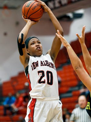 New Albany's Chyna Anthony pulls up for the jump shot against North High.Dec. 17, 2016