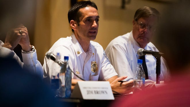 Goodyear Fire Chief Paul Luizzi participates in a public safety discussion at Pebble Creek Resort Community on Thursday, February 27, 2014 in Goodyear, Arizona.
