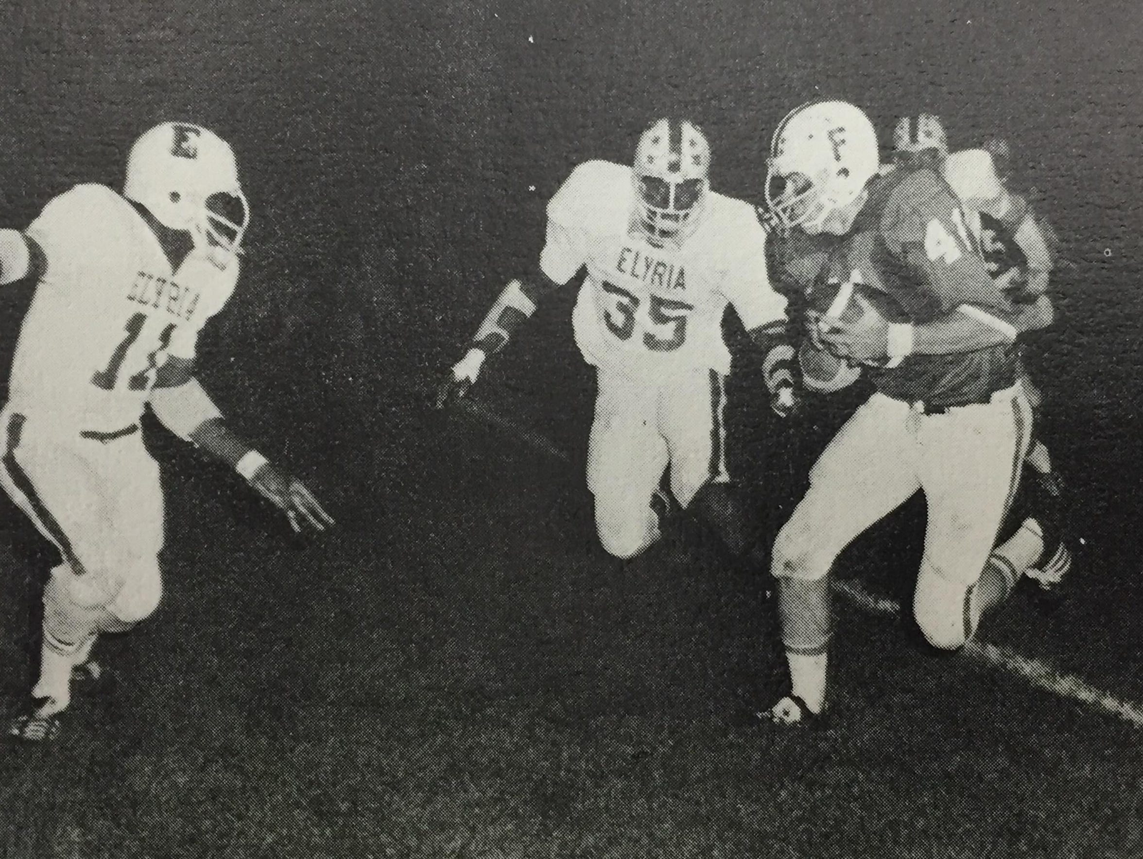 Rob Lytle runs the football against Elyria during his