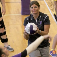 Fowlerville Coach Michelle Hardenbrook serves up an easy set for her players during warmup at FHS.