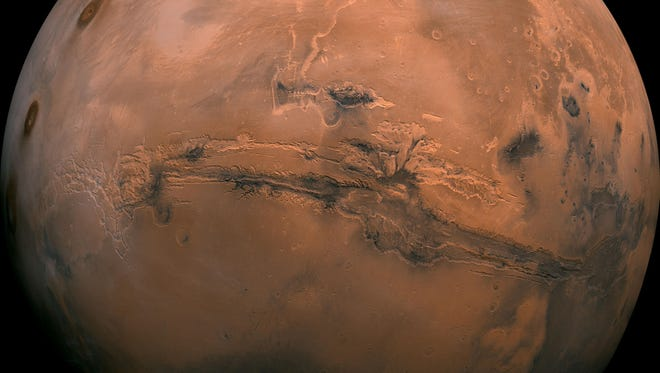 Global view of Mars showing Valles Marineris the grandest canyon in the solar system.