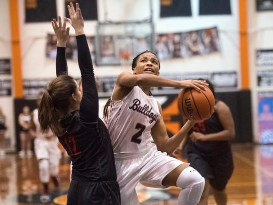 Bearden's Trinity Lee attempts to score while defended