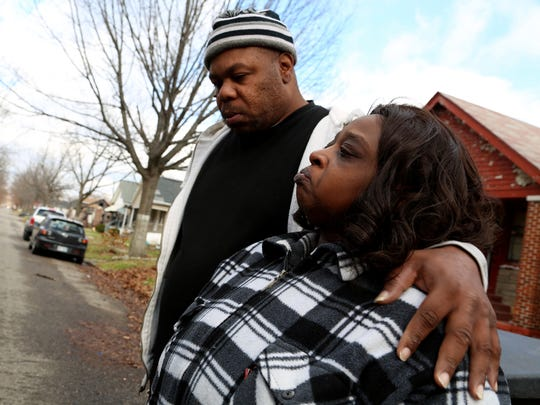 Clarence and Lucillie Strickland of Detroit stand near their home on Thursday,  one block from where their 4-year-old son, Xavier Strickland, was mauled to death by pit bulls the previous day. Lucille Strickland recounted how she laid on top of her son trying to shield and protect him from the pit bulls, but they pulled her son underneath a gate.