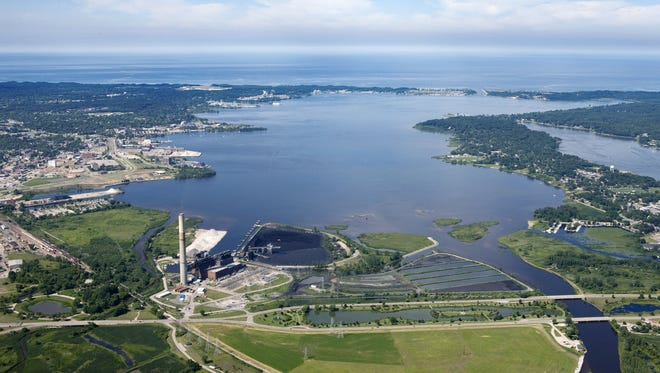 An aerial view of Muskegon Lake and Lake Michigan  Marge.