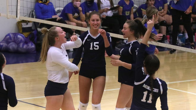 TMP players celebrate after winning a point on Thursday against Norton at Al Billinger Fieldhouse.