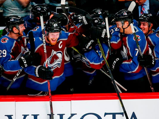 FILE - This April 7, 2018 file photo shows Colorado Avalanche left wing Gabriel Landeskog celebrating with teammates during the third period of an NHL hockey game against the St. Louis Blues in Denver. Landeskog has galvanized a youthful squad. They've bought in and followed Landeskog's lead straight into the postseason. The Avalanche will take on Nashville in the first round. (AP Photo/Jack Dempsey, file)