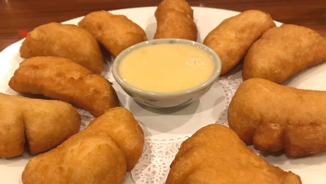 Spice Thai & Sushi's doughnuts were light, airy, fried, fritter-like dough that were not too sweet. They were served with a sweetened condensed milk dip.