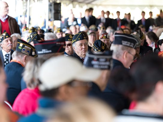 Large numbers of veterans attend a Veterans Day celebration