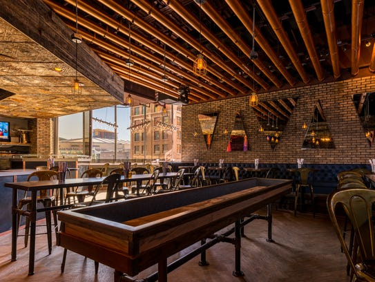 The new back area of Copper Blues now features shuffleboard