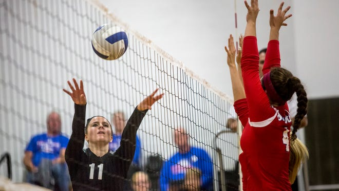 Marine City's Karyssa Austin sets the ball during a volleyball game Thursday, September 29, 2016 at Marine City High School.