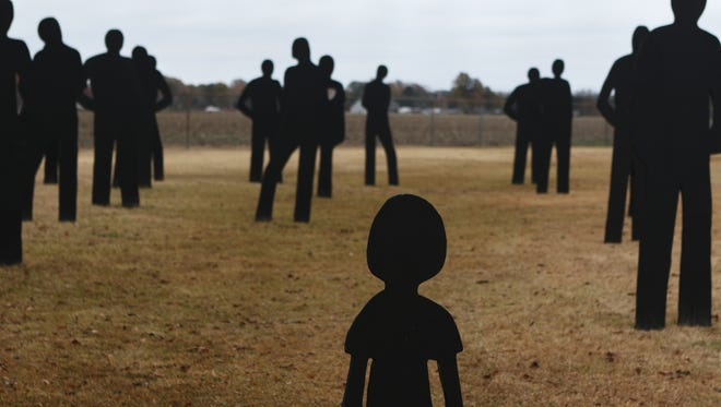 Thirty-five wooden cutouts, painted black, stand outside the Louisiana State Police Troop F headquarters on Louisiana Hwy 594 on Tuesday, December 6, 2016. Each cutout represents one person who died in a car crash in the troop's 12-parish coverage area.