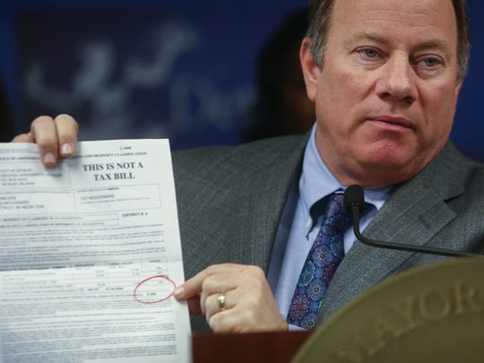 Detroit Mayor Mike Duggan announces the details of sweeping changes being made to the city's residential 2014 property assessments on  January 27  at City Hall in Detroit.