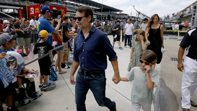 NASCAR legend Jeff Gordon and his family make their way to the yard of bricks before the start of the Brickyard 400 Sunday, July 23, 2017, at Indianapolis Motor Speedway.