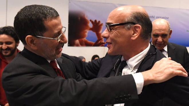 Chafik Chraibi, right, head of the Moroccan Association for the Fight against Clandestine Abortion, chats with Saad Eddine El-Othmani, member of the Justice and Development Partyduring an informal meeting on the abortion in Morocco on March 11 , 2015 in the capital Rabat.