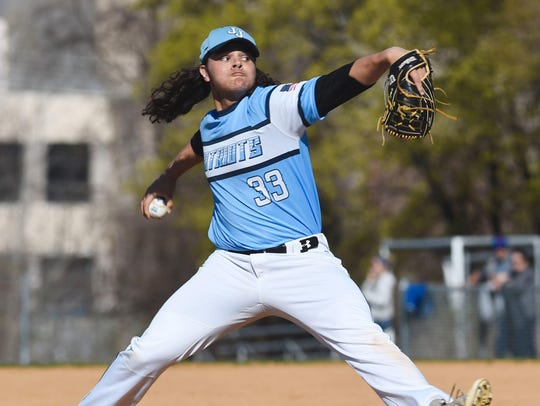 John Jay's Trent Valentine delivers a pitch during