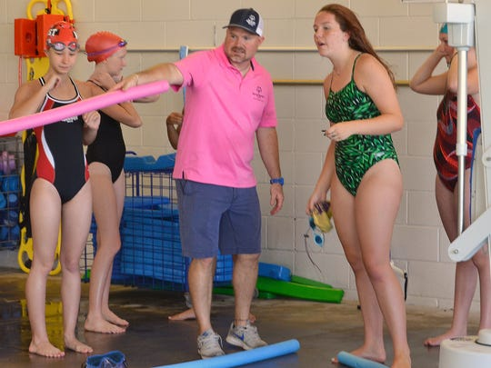 """VERNON -- Mike Strickland, area director for Special Olympics Texas, gives instructions to swimmers taking part in a fun relay that concluded the swim meet Saturday at Vernon College. He told swimmers the only prize for the fun event was a """"high five."""""""